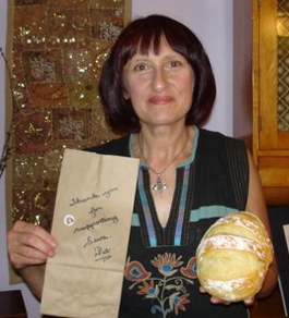 "The brown paper bag reads, ""Thank you for your support of Seva. Pat"""
